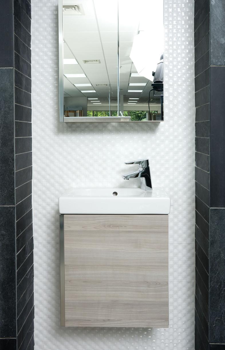 Roca mini unit with mirrored cabinet and Esmai basin mixer