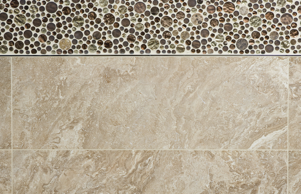 Porcelanosa Verona wall tile with Treasures Bronze Empera Moon mosaic and Butech chrome on brass trim